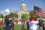 Protesters gather at the State Capitol in Atlanta Friday, June 5, 2020 in memory of George Floyd, who died after being restrained by Minneapolis police officers on May 25. (Steve Schaefer/Atlanta Journal-Constitution via AP)
