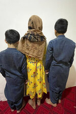 This September 2021 photo provided by their mother shows three children in Afghanistan. Every night, their father, a U.S. green card holder from California, and his wife take turns sleeping, with one always awake to watch over their three young children so they can flee if they hear the footsteps of the Taliban. (AP Photo)