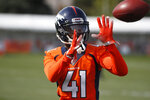 FILE - In this July 30, 2019, file photo, Denver Broncos cornerback DeVante Bausby (41) warms up during an NFL football training camp session at the team's headquarters in Englewood, Colo. Bausby played for the San Antonio Commanders in the now-defunct Alliance of American Football. Not all the AAF exiles were able to secure a new job so quickly, if at all, but for those that played in the failed developmental league it at least provided some bonus playing time even if the experience so ended abruptly and awkwardly.(AP Photo/David Zalubowski, File)