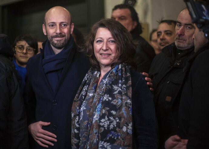 French Health Minister Agnes Buzyn, center, with deputy of the parliament Stanislas Guerini after she announces her resignation as she leaves the Health Ministry, in Paris, France, Sunday, Feb. 16, 2020. She had been chosen by the French centre-right ruling party La Republique en Marche to run for mayor of Paris next month, replacing Benjamin Griveaux. (AP Photo/Rafael Yaghobzadeh)