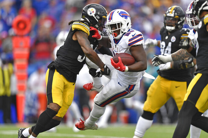 Buffalo Bills running back Devin Singletary (26) is tackled by Pittsburgh Steelers strong safety Terrell Edmunds, left, during the second half of an NFL football game in Orchard Park, N.Y., Sunday, Sept. 12, 2021. The Steelers won 23-16. (AP Photo/Adrian Kraus)