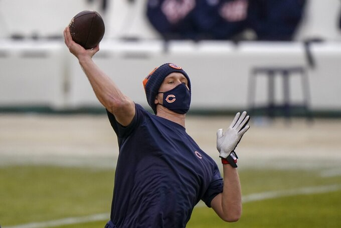 Chicago Bears' Nick Foles warms up before an NFL football game against the Green Bay Packers Sunday, Jan. 3, 2021, in Chicago. (AP Photo/Nam Y. Huh)