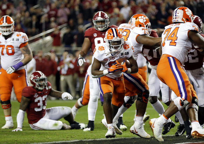 Clemson's Travis Etienne reacts after his touchdown during the first half of the NCAA college football playoff championship game against Alabama, Monday, Jan. 7, 2019, in Santa Clara, Calif. (AP Photo/David J. Phillip)