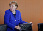 German Chancellor Angela Merkel arrives for the weekly cabinet meeting at the chancellery in Berlin, Germany, Wednesday, May 15, 2019. (AP Photo/Michael Sohn)