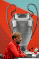 Liverpool manager Juergen Klopp gives a press conference at the Liverpool soccer team media open day, in Liverpool, England, Tuesday, May 28, 2019, ahead of their Champions League Final soccer match against Tottenham on Saturday in Madrid. (AP Photo/Rui Vieira)