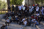 """Palestinians take part in a protest at the Damascus Gate to the Old City of Jerusalem Thursday, June 17, 2021 against incendiary chants used by ultranationalist Israelis at their """"Flags March"""" at the same site on Monday. (AP Photo/Maya Alleruzzo)"""