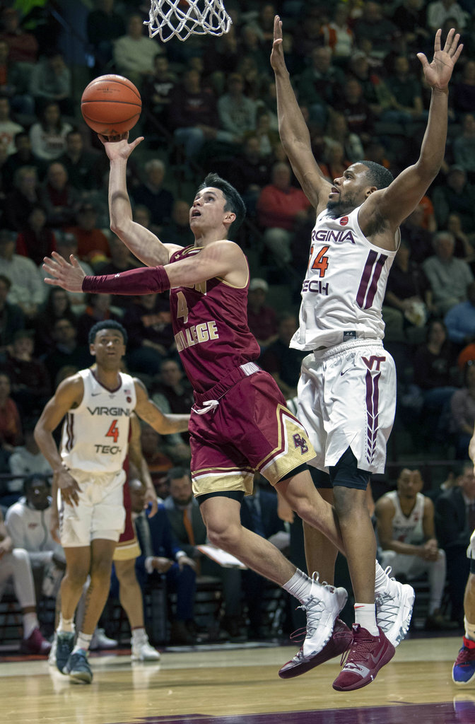 Boston College guard Chris Herren Jr. (4) shoots a basket against Virginia Tech forward P.J. Horne (14) during the first half of an NCAA college basketball game Saturday, Jan. 5, 2019, in Blacksburg, Va. Tech won 77-66. (AP Photo/Don Petersen)