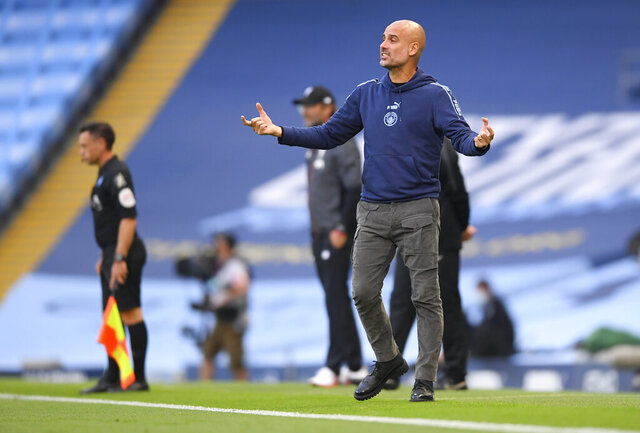 Manchester City's head coach Pep Guardiola gestures during the English Premier League soccer match between Manchester City and Liverpool at Etihad Stadium in Manchester, England, Thursday, July 2, 2020. (AP Photo/Laurence Griffiths,Pool)