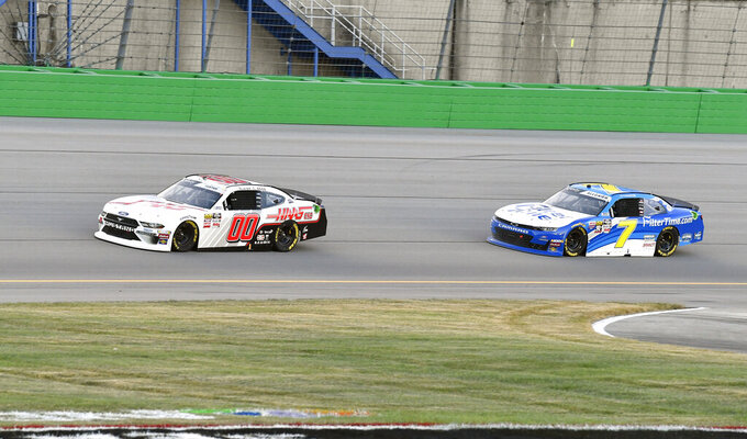 Cole Custer (00) pulls away from the challenge of Justin Allgaier (7) during an Xfinity Series auto race at Kentucky Speedway in Sparta, Ky., Friday, July 12, 2019. (AP Photo/Timothy D. Easley)