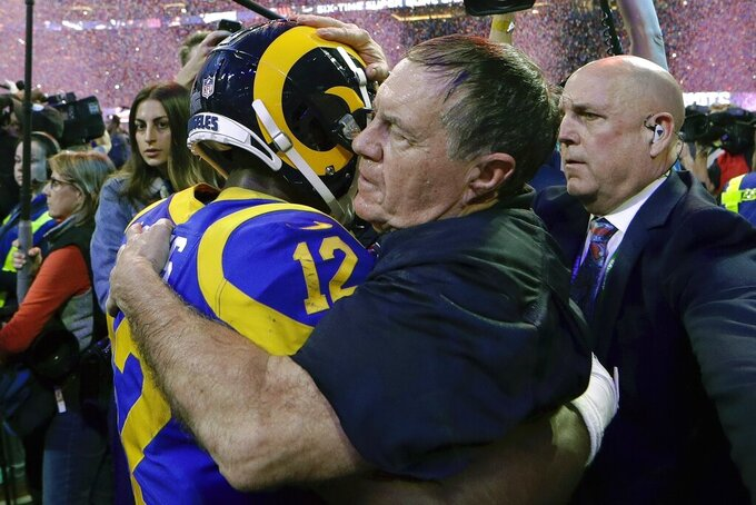 New England Patriots head coach Bill Belichick embraces Los Angeles Rams' Brandin Cooks (12) after the NFL Super Bowl 53 football game Sunday, Feb. 3, 2019, in Atlanta. The Patriots won 13-3. (AP Photo/David J. Phillip)