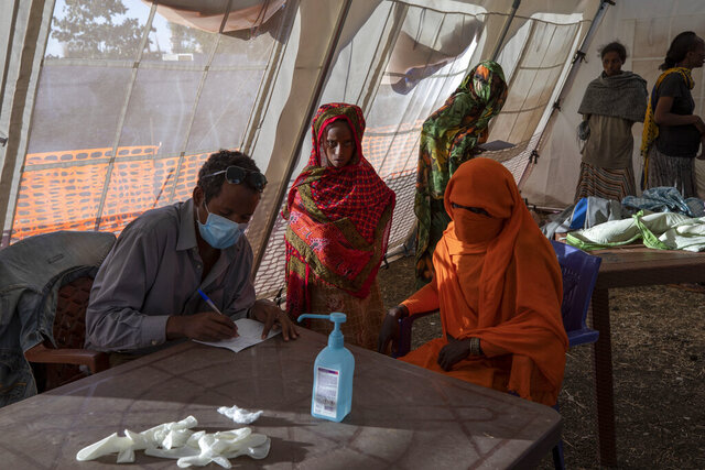 Tigray refugees who fled a conflict in the Ethiopia's Tigray region, receive treatment at a clinic run by MSF (Doctors Without Borders) in Village 8, the transit center near the Lugdi border crossing, eastern Sudan, Tuesday, Dec. 8, 2020. (AP Photo/Nariman El-Mofty)