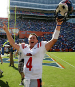 FILE - In this Sept. 27, 2008, file photo, Mississippi quarterback Jevan Snead celebrates after the defeated No. 4 Florida 31-30 in an NCAA college football game in Gainesville, Fla. Snead, the former Mississippi quarterback who ranks among the school's career passing leaders, has died in Texas. He was 32. Police say officers responding to a deceased-person call found Snead dead in Austin, Texas, Saturday night, Sept. 21, 2019. Austin police provided no information except to say Snead's death isn't considered suspicious. (AP Photo/John Raoux, File)