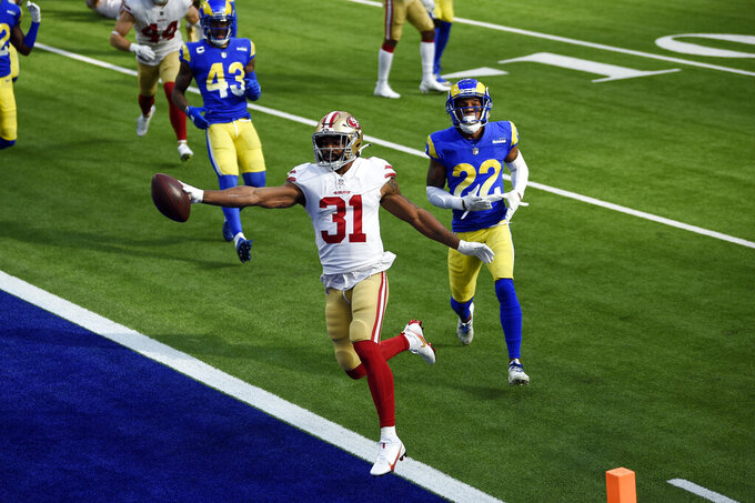 San Francisco 49ers running back Raheem Mostert scores a rushing touchdown against the Los Angeles Rams during the first half of an NFL football game Sunday, Nov. 29, 2020, in Inglewood, Calif. (AP Photo/Kelvin Kuo)