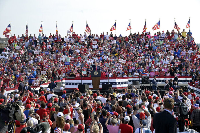 President Donald Trump addresses supporters during a campaign rally at the Ocala International Airport, Friday, Oct. 16, 2020, in Ocala, Fla. (AP Photo/Phelan M. Ebenhack)