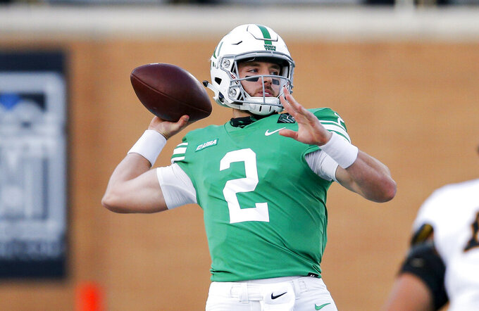 North Texas quarterback Austin Aune throws a pass during the first half of the team's NCAA college football game against Southern Mississippi on Saturday, Oct. 3, 2020, in Denton, Texas. (AP Photo/Brandon Wade)