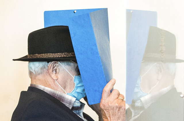 A 93-year-old former SS guard of the Stutthof concentration camp near Danzig in Poland  is pushed into a courtroom in the regional court in Hamburg, Germany, Thursday, July 23, 2020. The Hamburg Regional Court sentenced the former guard to two years juvenile sentence on probation. The juvenile court found him guilty of aiding and abetting murder in 5232 cases and of aiding and abetting attempted murder. (Daniel Bockwoldt/dpa via AP)
