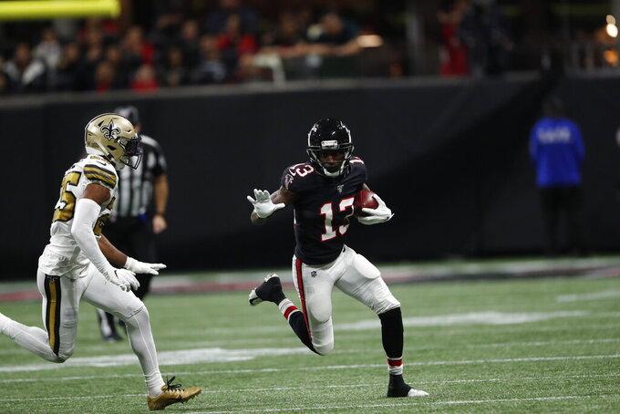 during the second half of an NFL football game, Thursday, Nov. 28, 2019, in Atlanta. (AP Photo/John Bazemore)