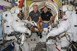 In this June 26, 2020 photo made available by NASA, spacewalkers Bob Behnken, foreground left, and Chris Cassidy, foreground right, are suited up with assistance from Expedition 63 Flight Engineers Doug Hurley, center left, and Ivan Vagner in the International Space Station. On Wednesday, July 29, 2020, SpaceX and NASA cleared the Dragon crew capsule to depart the International Space Station and head home after a two-month flight. (NASA via AP)
