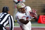 Boston College wide receiver Zay Flowers makes a touchdown reception during the first half of an NCAA college football game against Notre Dame, Saturday, Nov. 14, 2020, in Boston. (AP Photo/Michael Dwyer)