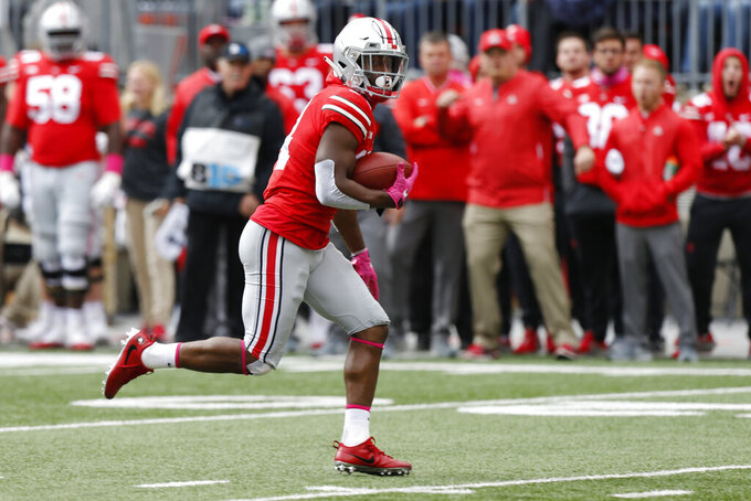 FILE - In this Oct. 13, 2018, file photo, Ohio State receiver K.J. Hill plays against Minnesota during an NCAA college football game in Columbus, Ohio. Hill is just 47 catches behind David Boston's career receptions record of 191, so he should reach that mark if he stays healthy. (AP Photo/Jay LaPrete, File)