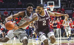 Texas A&M's TJ Starks (2) steals the ball from Mississippi guard Blake Hinson (0) during an NCAA college basketball game in Oxford, Miss., Wednesday, Feb. 6, 2019. (Bruce Newman/The Oxford Eagle via AP)