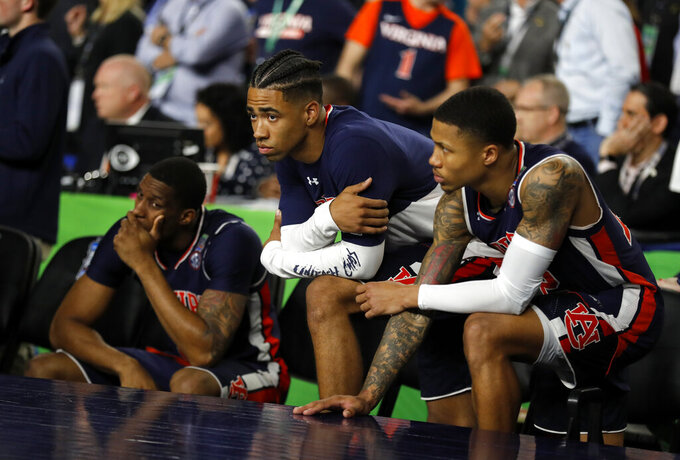 Auburn players react after the team's 63-62 loss to Virginia in the semifinals of the Final Four NCAA college basketball tournament, Saturday, April 6, 2019, in Minneapolis. (AP Photo/Charlie Neibergall)