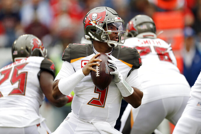 """FILE - In this Oct. 27, 2019, file photo, Tampa Bay Buccaneers quarterback Jameis Winston (3) passes against the Tennessee Titans before an NFL football game Sunday, Oct. 27, 2019, in Nashville, Tenn. A person familiar with the situation says the Saints and Winston are working on a contract proposal to make the former Buccaneers starter a backup to Drew Brees in New Orleans. The person said Sunday, April 26, 2020, that the Saints and Winston are in """"advanced"""" talks to get a deal done. The person spoke to The Associated Press on condition of anonymity because negotiations were ongoing. (AP Photo/James Kenney, File)"""