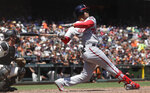 Washington Nationals' Juan Soto swings while flying out against the San Francisco Giants during the fourth inning of a baseball game in San Francisco, Wednesday, Aug. 7, 2019. (AP Photo/Jeff Chiu)