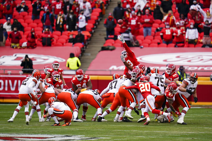 Cleveland Browns place kicker Cody Parkey, left, kicks a 46-yard field goal during the first half of an NFL divisional round football game against the Kansas City Chiefs, Sunday, Jan. 17, 2021, in Kansas City. (AP Photo/Jeff Roberson)