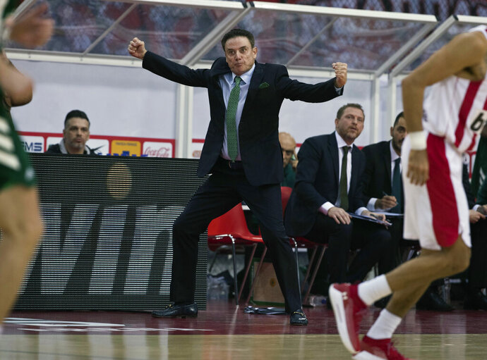FILE - In this Jan. 4, 2019, file photo, Panathinaikos coach Rick Pitino reacts during a Euroleague basketball match between Panathinaikos and Olympiakos in Piraeus near Athens, Greece. Greece's government has condemned a walkout by the basketball club Olympiakos during a Greek Cup semifinal game against rival Panathinaikos following complaints over the refereeing. Olympiakos forfeited the game at Olympic Stadium in Athens on Wednesday, Feb. 13, 2019, leaving at halftime and trailing 40-25. A spokesman for the team said he was