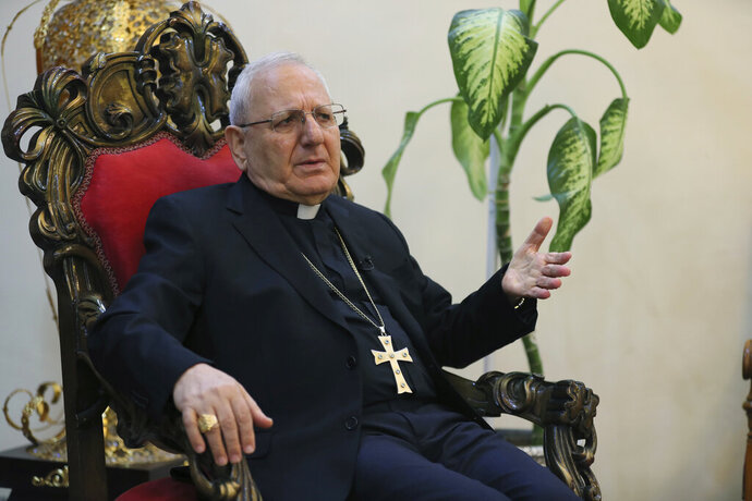 In this Thursday, Dec. 5, 2019 photo, Cardinal Louis Raphael Sako, patriarch of the Chaldean Church, speaks during an interview with The Associated Press in Baghdad, Iraq. Leaders of Iraq's Christians unanimously cancelled Christmas-related celebrations in solidarity with the protest movement - but the aims of their stance go deeper than tinsel and fairy lights. In the slogans calling for a united Iraq, Christians see hope for much needed change from a sectarian system that has long marginalized them. (AP Photo/Khalid Mohammed)