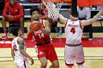 Ohio State forward Justice Sueing (14) drives to the basket past Rutgers guard Paul Mulcahy during the second half of an NCAA college basketball game Saturday, Jan. 9, 2021, in Piscataway, N.J. Ohio State won 79-68. (AP Photo/Adam Hunger)