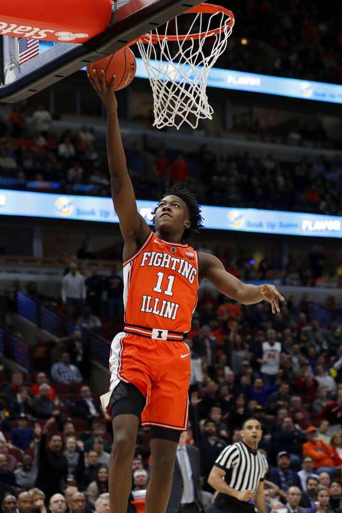 Illinois's Ayo Dosunmu (11) goes up for a lay up during the first half of an NCAA college basketball game against the Iowa in the second round of the Big Ten Conference tournament, Thursday, March 14, 2019, in Chicago. (AP Photo/Nam Y. Huh)