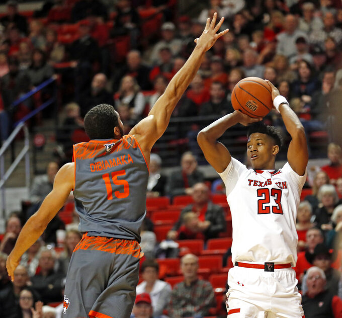 Texas Tech's Jarrett Culver (23) looks to pass the ball around Texas-Rio Grande Valley's Uche Dibiamaka (15) during the second half of an NCAA college basketball game Friday, Dec. 28, 2018, in Lubbock, Texas. (AP Photo/Brad Tollefson)