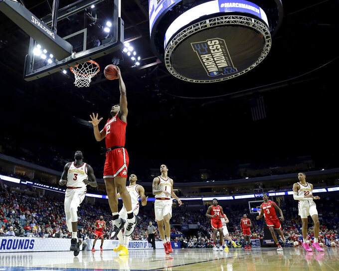 Ohio State's Musa Jallow (2) gets past Iowa State's Marial Shayok (3) to put up a shot during the first half of a first round men's college basketball game in the NCAA Tournament Friday, March 22, 2019, in Tulsa, Okla. (AP Photo/Charlie Riedel)
