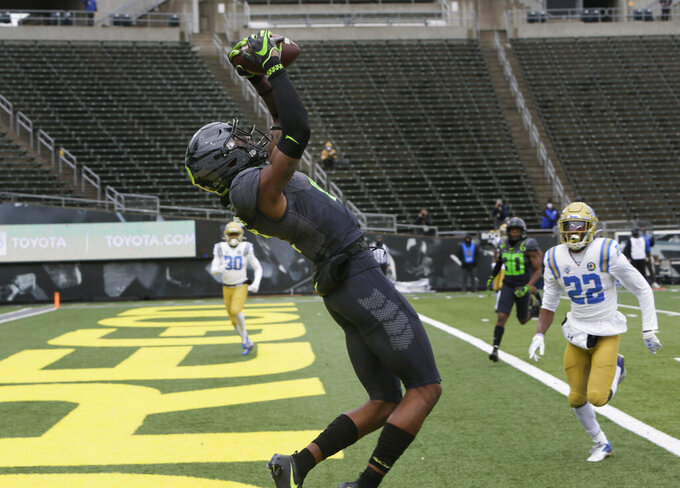 Oregon's Devon Williams pulls down in a Tyler Shough pass for a touchdown against UCLA during the first quarter of an NCAA college football game Saturday, Nov. 21, 2020, in Eugene, Ore. (AP Photo/Chris Pietsch)
