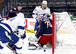 Tampa Bay Lightning forward Barclay Goodrow (19) scores past Columbus Blue Jackets goalie Joonas Korpisalo (70) in front of Blue Jackets defenseman Zach Werenski (8) and Lightning forward Yanni Gourde (37) during the first period an NHL hockey game in Columbus, Ohio, Thursday, April 8, 2021. (AP Photo/Paul Vernon)