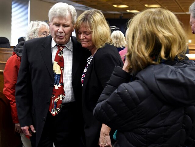 FILE - In this Feb. 2, 2018, file photo, Dr. Chris Christensen and his wife, Gayle, leave the Ravalli County Courthouse in Hamilton after Christensen was sentenced to prison for his role in the overdose deaths of two of his patients. A split Montana Supreme Court has overturned Christensen's convictions for negligent homicide in the overdose deaths of two of his patients. Justices said Wednesday, Sept. 16, 2020, the state did not present sufficient evidence to establish that Christensen's actions in prescribing narcotics were the direct cause of the deaths of Greg Griffin in 2012 and Kara Philbrick in 2013. (Kurt Wilson/The Missoulian via AP, File)