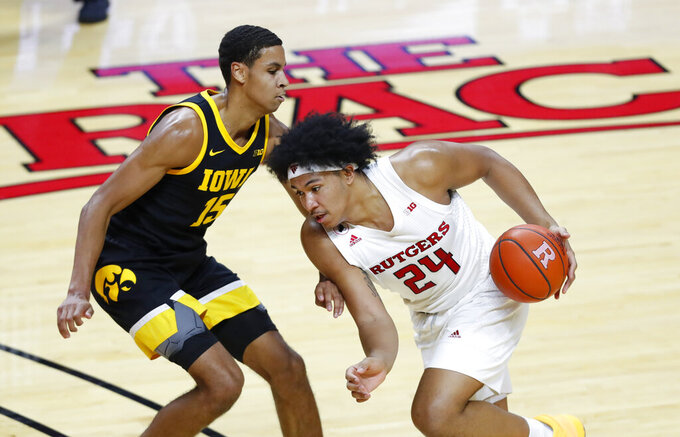 Rutgers guard Ron Harper Jr. (24) drives to the basket against Iowa forward Keegan Murray (15) during the second half of an NCAA college basketball game in Piscataway, N.J., Saturday, Jan. 2, 2021. (AP Photo/Noah K. Murray)