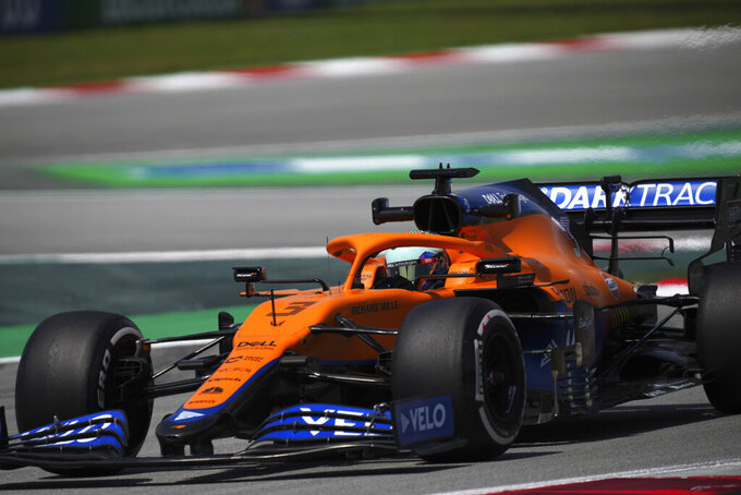 Mclaren driver Daniel Ricciardo of Australia steers his car during the first free practice for the Spanish Formula One Grand Prix at the Barcelona Catalunya racetrack in Montmelo, just outside Barcelona, Spain, Friday, May 7, 2021. The Spanish Grand Prix will be held on Sunday. (AP Photo/Emilio Morenatti)