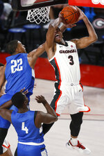 Georgia's Christian Brown (3) shoots while being defended by North Georgia forward Eric Jones (22) during an NCAA college basketball game in Athens, Ga., Wednesday, Dec. 2, 2020. (Joshua L. Jones/Athens Banner-Herald via AP)