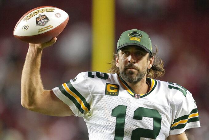 Green Bay Packers quarterback Aaron Rodgers (12) gestures as he jogs off the field after the Packers defeated the San Francisco 49ers in an NFL football game in Santa Clara, Calif., Sunday, Sept. 26, 2021. (AP Photo/Tony Avelar)