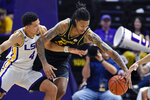 LSU guard Skylar Mays (4) and Missouri forward Mitchell Smith (5) battle for control of a loose ball in the first half of an NCAA college basketball game, Tuesday, Feb. 11, 2020, in Baton Rouge, La. (AP Photo/Bill Feig)