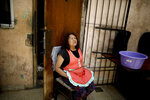 Peruvian Victoria Narciso Victorio sits inside her home in Buenos Aires, Argentina, Tuesday, Oct. 29, 2019.Narciso said that she is happy with  Sunday's election results and hopes that Alberto Fernandez and Cristina Fernandez de Kirchner can change and improve the lives of all citizens. (AP Photo/Natacha Pisarenko)