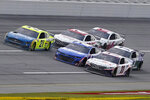 Denny Hamlin (11) races William Byron (24) and Matt DiBenedetto (21) to the finish line during the YellaWood 500 NASCAR auto race at Talladega Superspeedway, Sunday, Oct. 4, 2020, in Talladega, Ala. Hamlin won. (AP Photo/John Bazemore)