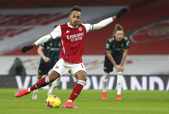 Arsenal's Pierre-Emerick Aubameyang shoots to score from the penalty spot during the English Premier League soccer match between Arsenal and Leeds United at the Emirates stadium in London, England, Sunday, Feb. 14, 2021. (Catherine Ivill/Pool via AP)