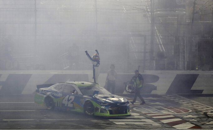 Kyle Larson celebrates after winning the NASCAR All-Star Race at Charlotte Motor Speedway in Concord, N.C., Saturday, May 18, 2019. (AP Photo/Chuck Burton)