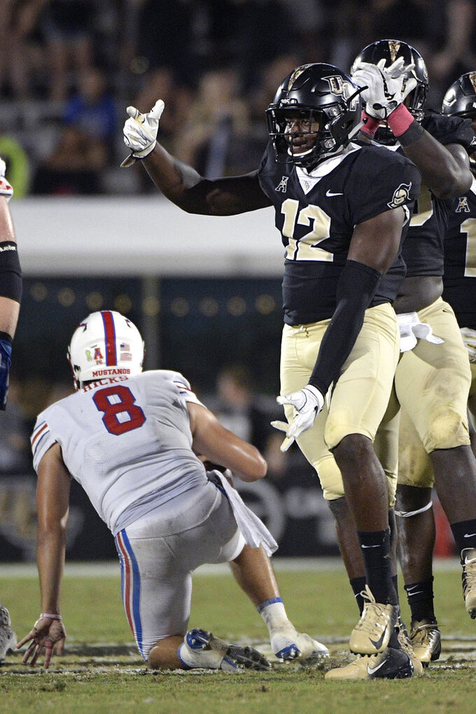 Central Florida linebacker Eric Mitchell (12) celebrates after sacking SMU quarterback Ben Hicks (8) during the second half of an NCAA college football game Saturday, Oct. 6, 2018, in Orlando, Fla. UCF won 48-20. (AP Photo/Phelan M. Ebenhack)