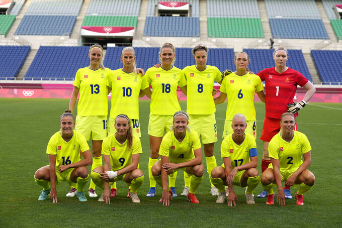 Sweden's players pose for a team photo prior to a women's soccer match against Australia at the 2020 Summer Olympics, Saturday, July 24, 2021, in Saitama, Japan. (AP Photo/Martin Mejia)