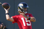 Jacksonville Jaguars quarterback Gardner Minshew II (15) throws a pass during an NFL football workout, Thursday, Aug. 13, 2020, in Jacksonville, Fla. (AP Photo/John Raoux)
